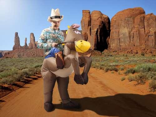 Oppustelig cowboy kostume